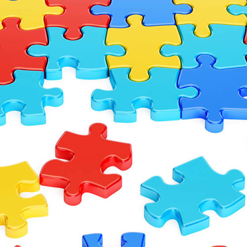 Puzzle Pieces in Autism Awareness Colors, 3D rendering isolated on white background